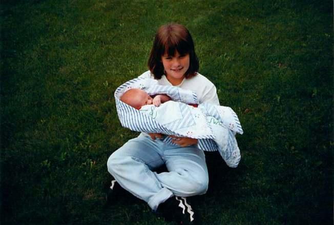 Miranda Holding Sam